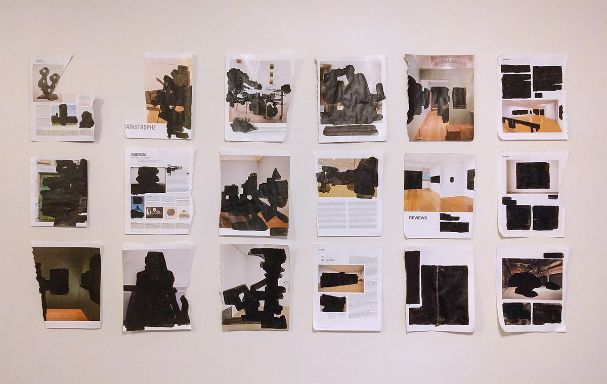 Eighteen magazine pages of blackout drawings pinned to wall in three rows of six.